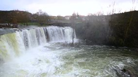 Panoramic view of a scenic waterfall on a rainy day in Pedrosa de Tobalina, Burgos, Spain. stock footage