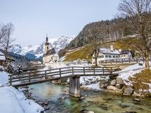 Panoramic view of scenic winter landscape in the Bavarian Alps with famous Parish Church of St. Sebastian in the village of Ramsau Royalty Free Stock Photography