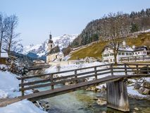 Panoramic view of scenic winter landscape in the Bavarian Alps with famous Parish Church of St. Sebastian in the village of Ramsau Royalty Free Stock Image
