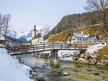 Panoramic view of scenic winter landscape in the Bavarian Alps with famous Parish Church of St. Sebastian in the village of Ramsau Royalty Free Stock Images
