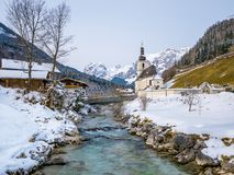 Panoramic view of scenic winter landscape in the Bavarian Alps with famous Parish Church of St. Sebastian in the village of Ramsau Stock Images