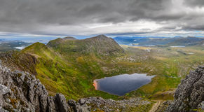 Panoramic view of Scottish highlands, mountains in Loch Assynt Royalty Free Stock Photography