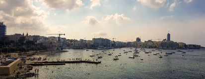 Panoramic view of the sea in Malta. SLIEMA, MALTA - AUGUST 05, 2018: panoramic view from Sliema of the sea with many small boats in a cloudy day Royalty Free Stock Photo