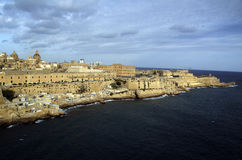 Panoramic view from the sea at Valletta city,Malta. Panoramic view from the sea at Valletta city buildings Stock Photo