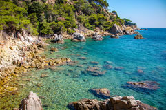 Panoramic view of seashore with rock cliff. In Costa Brava, Spain Stock Photography