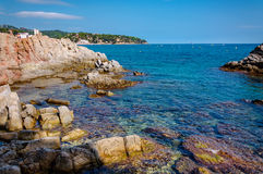 Panoramic view of seashore with rock cliff. In Costa Brava, Spain Stock Images