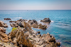 Panoramic view of seashore with rock cliff. In Costa Brava, Spain Royalty Free Stock Photography