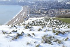 Panoramic view of Seaton. In East Devon on a snowy day Royalty Free Stock Photo