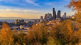 Panorama of Seattle downtown skyline at sunset in the fall with yellow foliage in the foreground from Dr. Jose Rizal Park. Panoramic view of Seattle downtown stock photo