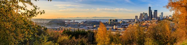 Panorama of Seattle downtown skyline at sunset in the fall with yellow foliage in the foreground from Dr. Jose Rizal Park. Panoramic view of Seattle downtown royalty free stock photography