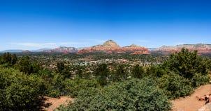 View of Sedona city in Arizona. Panoramic view of Sedona city in Arizona, USA. Green plants on the foreground Royalty Free Stock Photography