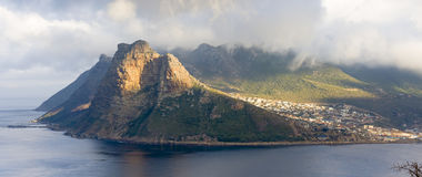 Panoramic view of the Sentinel rock guarding Hout Bay harbor on the Cape Peninsula near to Cape Town in South Africa. The view is. The Cape Peninsula is a Stock Image