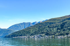 Panoramic view of serene Lugano lake surrounded by hills in Switzerland Royalty Free Stock Image
