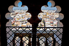 Panoramic view on Seville through windows of Saint Mary cathedra Royalty Free Stock Photo