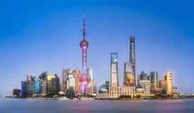 Panoramic view of Shanghai skyline, China. Panoramic view of Shanghai skyline and Huangpu river with blue clear sky on background, China Royalty Free Stock Image