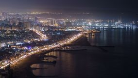 Panoramic view of Sharjah coastline from Ajman rooftop timelapse - third largest and most populous city in United Arab Emirates. Panoramic view of Sharjah royalty free stock photo
