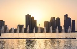Panoramic view of Sharjah waterfront in UAE at sunset. Panoramic sunset view of Sharjah waterfront cityscape in UAE Stock Images