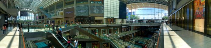 Panoramic view of The Shoppes inside the mall at Marina Bay Sands Singapore stock photography