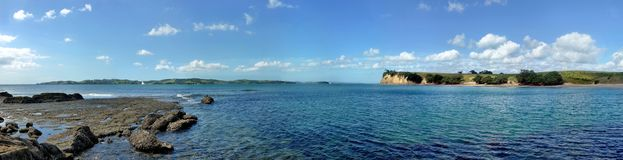 Panoramic view from a shore onto the sea with islands Royalty Free Stock Photos