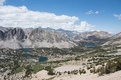 Panoramic View of the Sierra Nevada Mountains. A view from Kearsarge Pass of Kings Canyon National Park, looking down on pine forest, lakes, and mountains stock photos