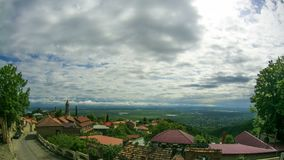 Panoramic View on the Sighnaghi City Landscape, Georgia. Timelapse. GEORGIA, SIGHNAGHI, MAY 12, 2017: Panoramic View on the Sighnaghi City Landscape, Georgia stock video footage
