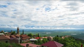 Panoramic View on the Sighnaghi City Landscape, Georgia. Timelapse. GEORGIA, SIGHNAGHI, MAY 12, 2017: Panoramic View on the Sighnaghi City Landscape, Georgia stock footage