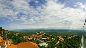 Panoramic View on the Sighnaghi City Landscape, Georgia. Timelapse. GEORGIA, SIGHNAGHI, MAY 12, 2017: Panoramic View on the Sighnaghi City Landscape, Georgia stock video