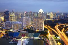 Aerial Singapore skyline night, city panorama. Panoramic view of Singapore cityscape from central business district Stock Photos