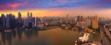 Aerial Singapore skyline dust, city panorama, sunset Stock Images