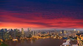 Aerial Singapore skyline night, city panorama, sunset. Panoramic view of Singapore cityscape from central business district, magical evening clouds Royalty Free Stock Photo