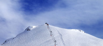 Panoramic view on ski slope and chair-lift. Royalty Free Stock Photo