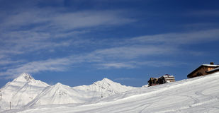 Panoramic view on ski slope and hotels in winter mountains Royalty Free Stock Image