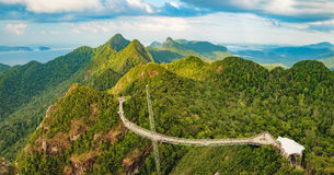 Panoramic view of Sky Bridge in Langkawi, Malaysia. Panoramic view of Sky Bridge and Cable Car with mountains, sea and tropical forests in the background royalty free stock photo
