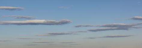 Long Slender Clouds in Evening Sky Stock Image