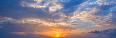 Panoramic view of the sky at sunset with clouds. Panoramic view of the sky at sunset with beautiful clouds Royalty Free Stock Image