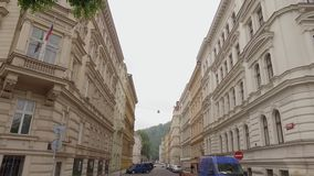 Panoramic view from sky to alleyway in european city in daytime, traditional architecture. Panoramic view from sky to alleyway in european city in daytime stock video footage