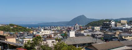 Panoramic view on Skyline of Beppu City and Bay. Town Oita in the Background. Beppu, Oita, Japan, Asia royalty free stock photo
