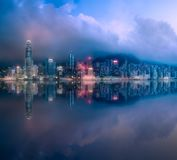 Skyline of Hong Kong in mist from Kowloon, China. Panoramic view and skyline of Hong Kong with reflection on water from Kowloon, China stock images
