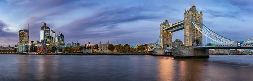 Panoramic view of the skyline of London during evening. From the Tower Bridge to the City of London royalty free stock images