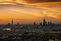 Panoramic view of the skyline of London during sunset. From the City to the Tower Bridge along the Thames river royalty free stock photography