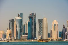 Panoramic view of the skyscrapers from the Persian Gulf. Futuristic skyline in the financial district of Qatar royalty free stock photos
