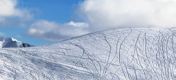 Panoramic view on slope for freeriding with traces from skis, sn. Panoramic view on snowy off piste slope for freeriding with traces from skis, snowboards and Stock Images