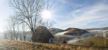 Panoramic view of  Small cottage in the mountains Royalty Free Stock Photos