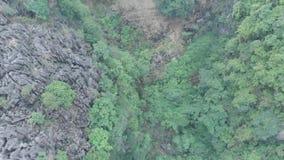 Small temple hidden between cliffs stock video
