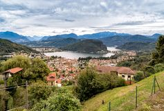 Panoramic view from small village Cadegliano Viconago of lake Lugano and Swiss Alps. Royalty Free Stock Photo