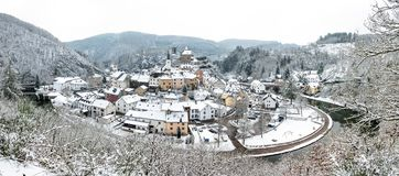 Panoramic view of snow covered Esch sur sure town in Luxembourg. Beautiful old town of Esch sur Sure hidden in the Ardennes forest on the Sure river bank Stock Photos
