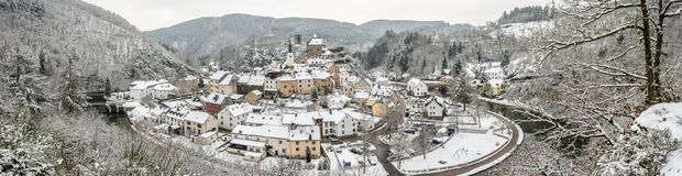 Panoramic view of snow covered Esch sur sure town in Luxembourg. Beautiful old town of Esch sur Sure hidden in the Ardennes forest on the Sure river bank Stock Photography