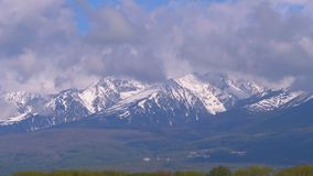 Panoramic view of the snow-covered High Tatras. Mountain peaks in the clouds stock footage