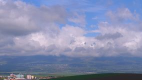 Panoramic view of the snow-covered High Tatras. Mountain peaks in the clouds stock video