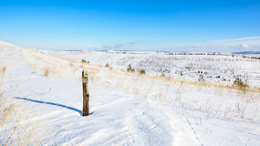 Panoramic view of the snow-covered hills. On a sunny day Royalty Free Stock Photos